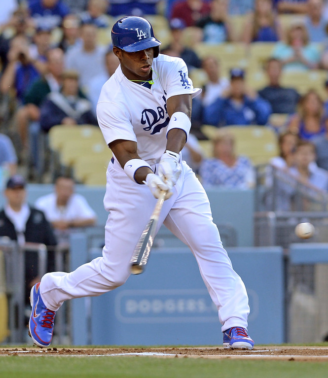 . New Dodger Yasiel Puig singles during his first Major League at bat against the Padres June 3, 2013 in Los Angeles, CA.(Andy Holzman/Staff Photographer)