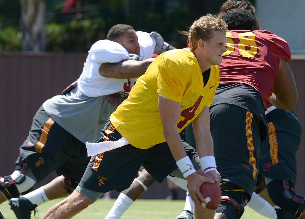. QB Max Brown pitches the ball. Football practice is in full swing on the Howard Jones Field at USC. Los Angeles, CA. 8/6/2014(Photo by John McCoy Daily News)