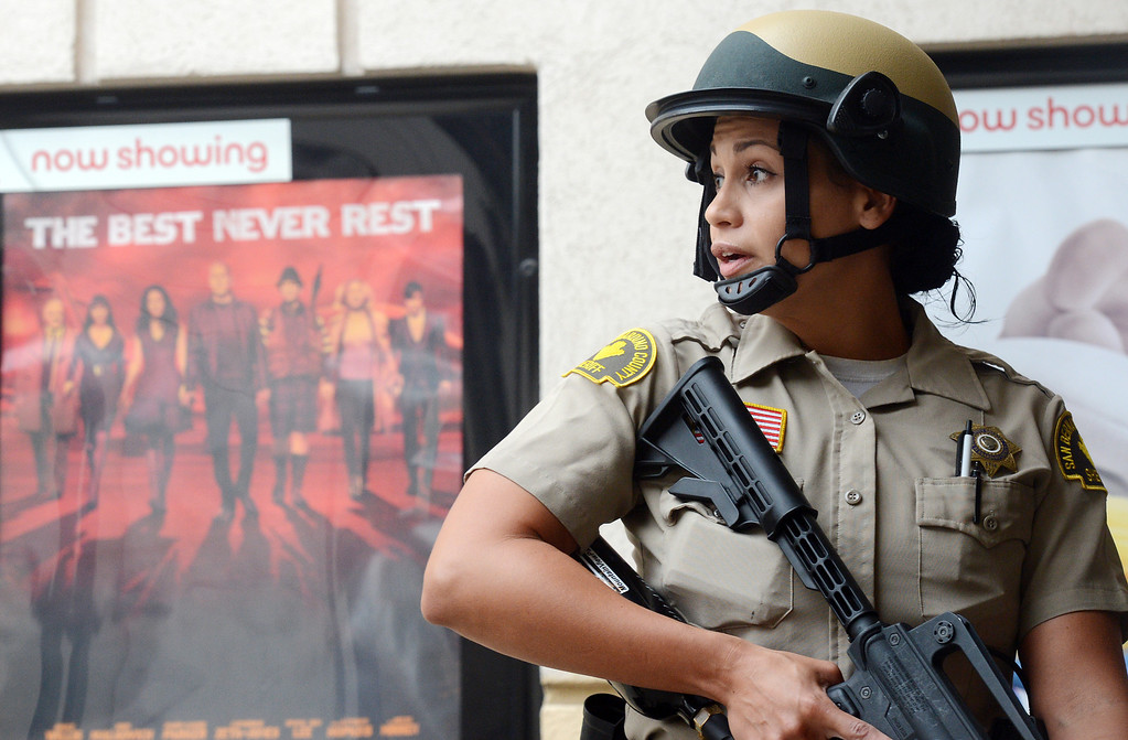 . (Will Lester/Inland Valley Daily Bulletin) A Rancho Cucamonga Sheriff deputy stands guard outside the movie theater during a mock theater shooting training drill Thursday morning August 1, 2013 at Victoria Gardens in Rancho Cucamonga.