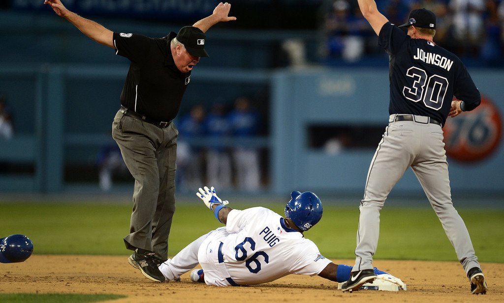 . Los Angeles Dodgers\' Yasiel Puig steels second on a an overthrow to first during game 3 of the NLDS at Dodger Stadium Sunday, October 6, 2013. (Photo by Hans Gutknecht/Los Angeles Daily News)
