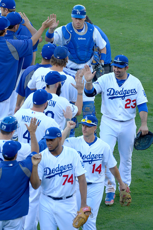 . The Dodgers celebrate after they defeated the Saint Louis Cardinals 6-4 in game 5 of the National League Championship Series at Dodger Stadium in Los Angeles, CA. 10/15/2013. photo by (John McCoy)/Los Angeles Daily News)