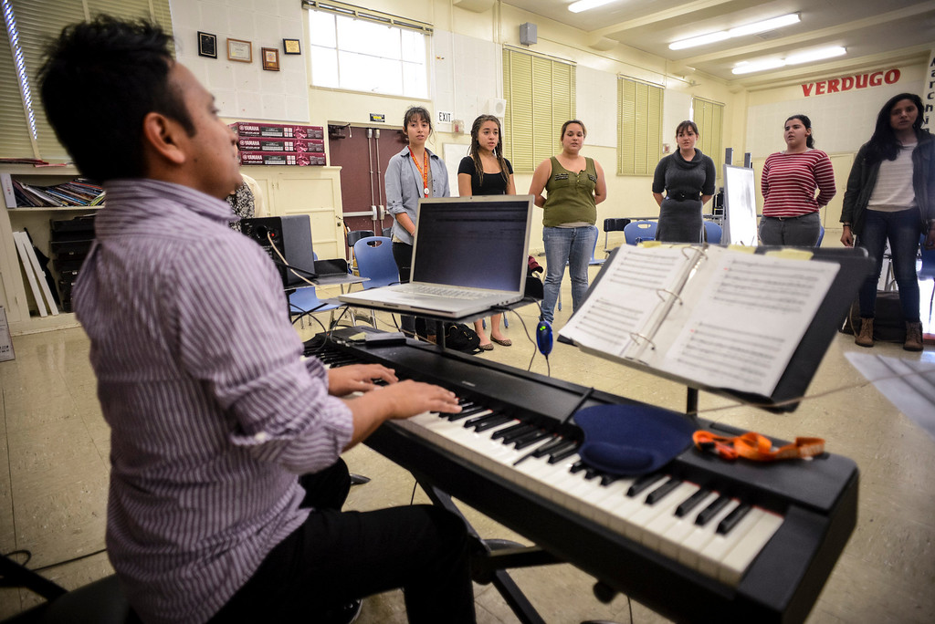 . Choir director Daniel Lopez, left, works with the Verdugo Hills High School Chorus after school on Tuesday, February 26, 2014.  The group will be one of the LAUSD groups to perform at the Arts Fest at Grand Central Park in Los Angeles on March 15th. (Photo by David Crane/Los Angeles Daily News)