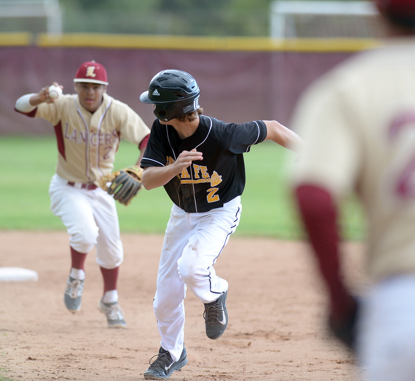 . Santa Fe\'s Zach Penticoff (#2) is caught in a pickle as they play La Serna in their Del Rio League baseball game at La Serna High School in Whittier on Wednesday April 2, 2014. Santa Fe defeated La Serna 2-0. (Staff Photo by Keith Durflinger/Whittier Daily News)