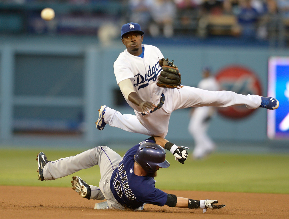 . Dodgers Dee Gordon gets tripped up by Rockies #19 Charlie Blackmon when he catches him at 2nd base for a force out in the 3rd inning. The Dodgers played the Colorado Rockies at Dodger Stadium in Los Angeles, CA. 6/18/2014(Photo by John McCoy Daily News)