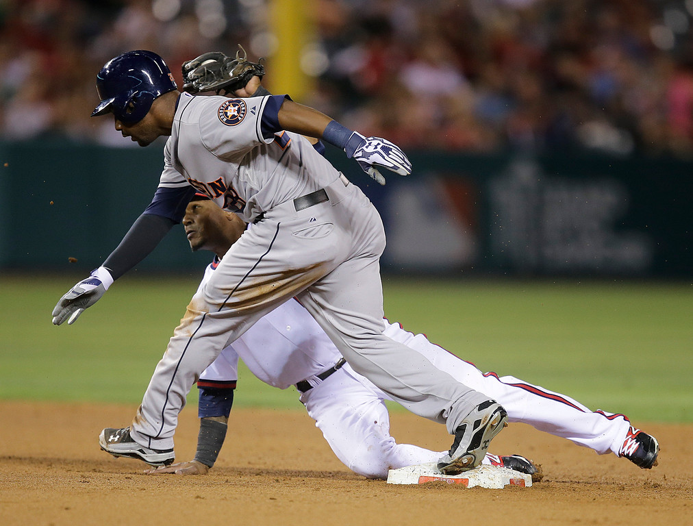 . Houston Astros\' L.J. Hoes, front, arrives at second base against Los Angeles Angels\' Erick Aybar after hitting a double during the fifth inning of a baseball game Friday, Aug. 16, 2013, in Anaheim, Calif. (AP Photo/Jae C. Hong)