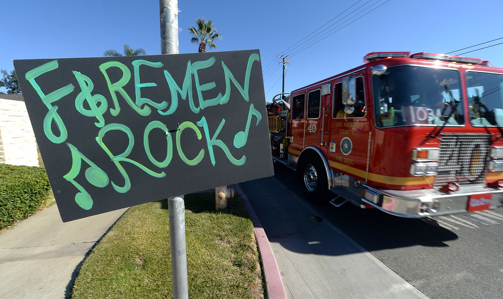 . A sign on Sierra Madre Boulevard in Glendora thanks firefighters for their efforts. Clean up efforts were underway Friday January 17, 2014 in Glendora and Azusa following the Colby Fire. Full containment is expected by Sunday. (Will Lester/Inland Valley Daily Bulletin)