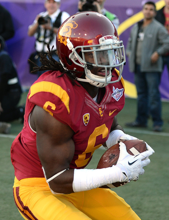 . LAS VEGAS, NV - DECEMBER 21:  Josh Shaw #6 of the USC Trojans intercepts a pass in the end zone against the Fresno State Bulldogs during the Royal Purple Las Vegas Bowl at Sam Boyd Stadium on December 21, 2013 in Las Vegas, Nevada. USC won 45-20.  (Photo by Ethan Miller/Getty Images)