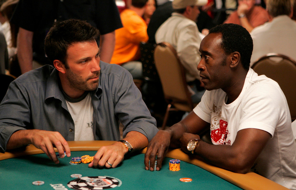 . Actors Don Cheadle, right, and Ben Affleck chat as they play during the Ante Up for Africa charity poker tournament of World Series  Poker in Las Vegas, Thursday, July 5, 2007.  (AP Photo/Jae C. Hong)