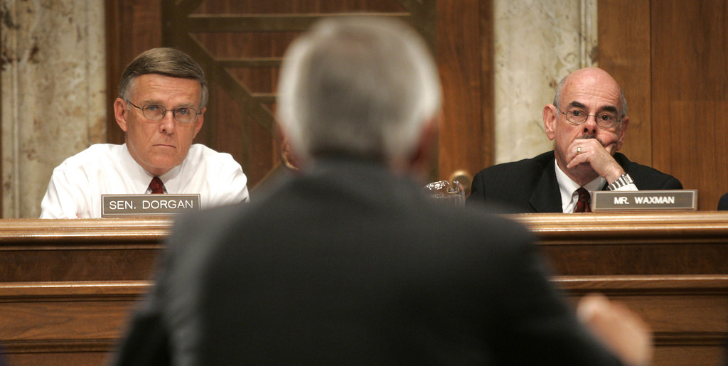 . In this July 22, 2005 file photo, Sen. Byron L. Dorgan, D-ND, left, and Rep. Henry Waxman. D-Ca., co-chairman of a Senate and House committee listen to testimony on Capitol Hill in Washington.  (AP Photo/Lawrence Jackson, File)