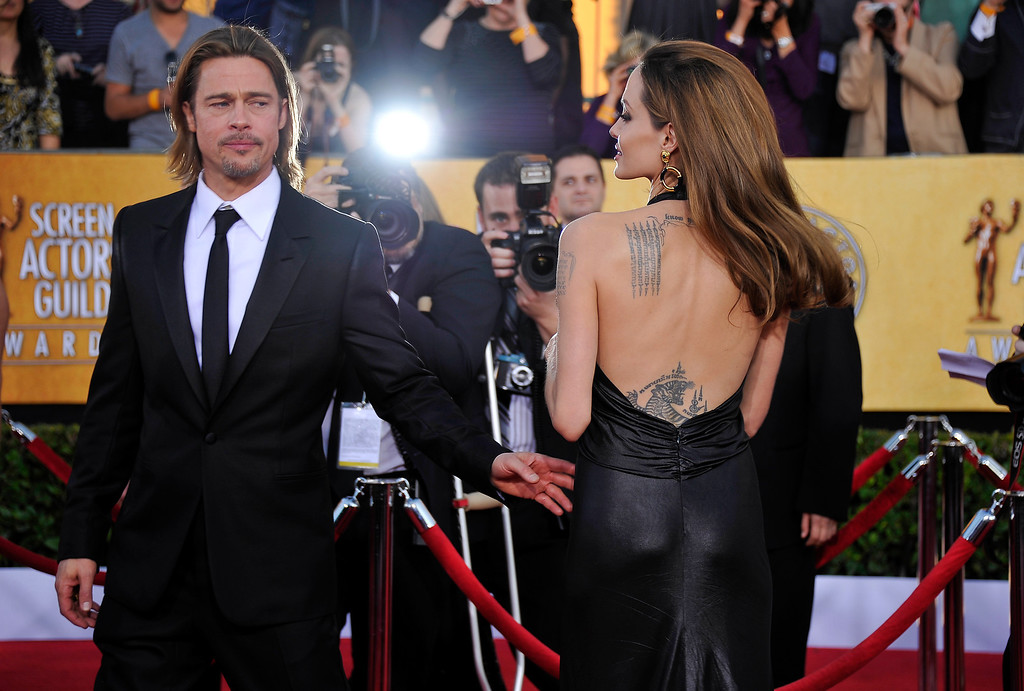 . Actors Brad Pitt and Angelina Jolie arrive to the 18th Annual Screen Actors Guild Awards at the Shrine Auditorium in Los Angeles, California on January 29, 2012. (JOE KLAMAR/AFP/Getty Images)