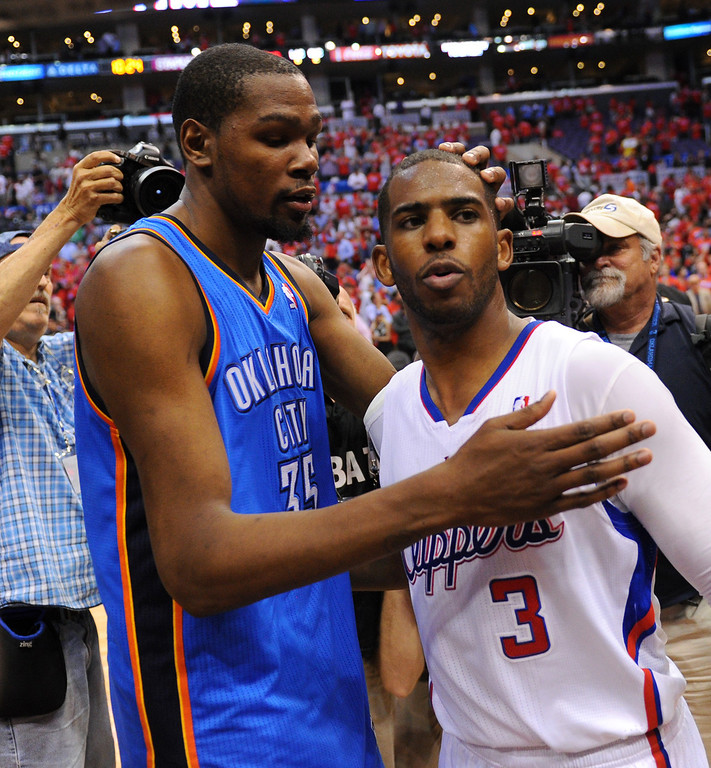 . The Clippers\' Chris Paul gets a pat from from the Thunder\'s Kevin Durant after the Thunder won the series 104-98, Thursday, May 15, 2014, at Staples Center. (Photo by Michael Owen Baker/Los Angeles Daily News)