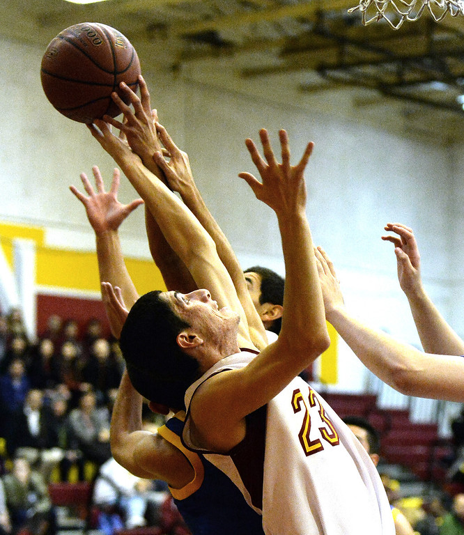. Wilson\'s Erick Ramos (23) reaches for a rebound against San Dimas in the first half of a prep basketball game at Wilson High School in Hacienda Heights, Calif., on Friday, Jan. 31, 2014. (Keith Birmingham Pasadena Star-News)