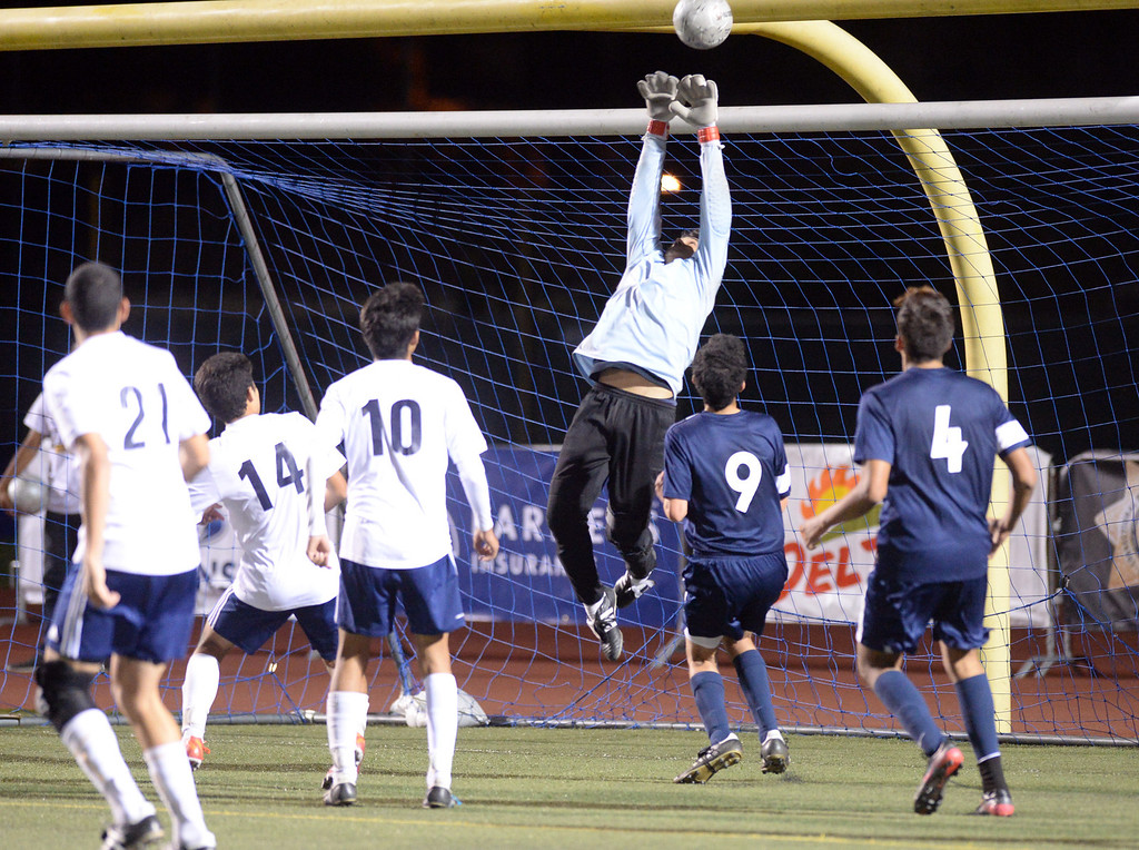 . Baldwin Park goalie Alfredo Guerra saves a goal as they play Marshall in their CIF-SS Division 5 boys soccer game at Warren High School in Downey on Friday March 7, 2014. Baldwin Park defeated Marshall 5-4 in penalty kicks after scoring 0-0 in overtime. (Staff Photo by Keith Durflinger/San Gabriel Valley Tribune)
