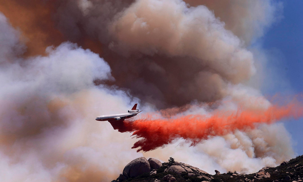 . A DC-10 tanker drops retardant on the Silver Fire as seen from Twin Pines Ranch in the mountains south of Banning August 8, 2013.    GABRIEL LUIS ACOSTA/STAFF PHOTOGRAPHER.