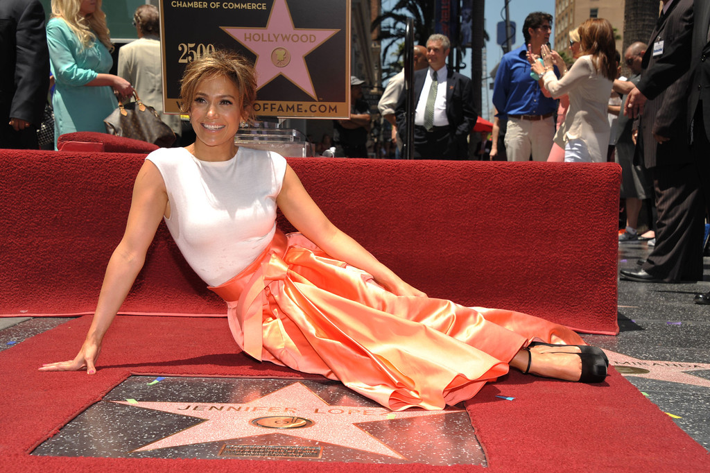 . Jennifer Lopez poses with her new star on the Hollywood Walk of Fame on Thursday, June 20, 2013 in Los Angeles. (Photo by John Shearer/Invision/AP)
