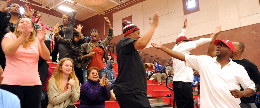 . View Park fans react after a three pointer against Renaissance Academy in the first half of a CIF Southern California Regional Division basketball game at Colony High School in Ontario, Calif., on Saturday, March 22, 2014.  (Keith Birmingham Pasadena Star-News)