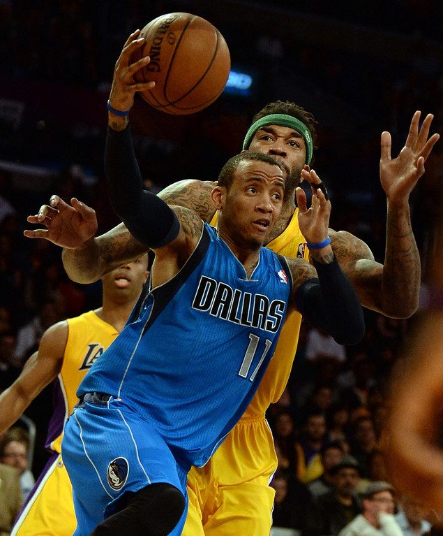 . Dallas Mavericks guard Monta Ellis (11) drives to the basket against Los Angeles Lakers in the second half during an NBA basketball game in Los Angeles, Calif., on Friday, April 4, 2014. Dallas Mavericks won 107-95.  (Keith Birmingham Pasadena Star-News)